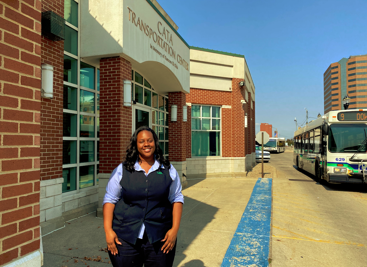 Customer Experience Representative Schuyler Brown poses in front of the CATA Transportation Center