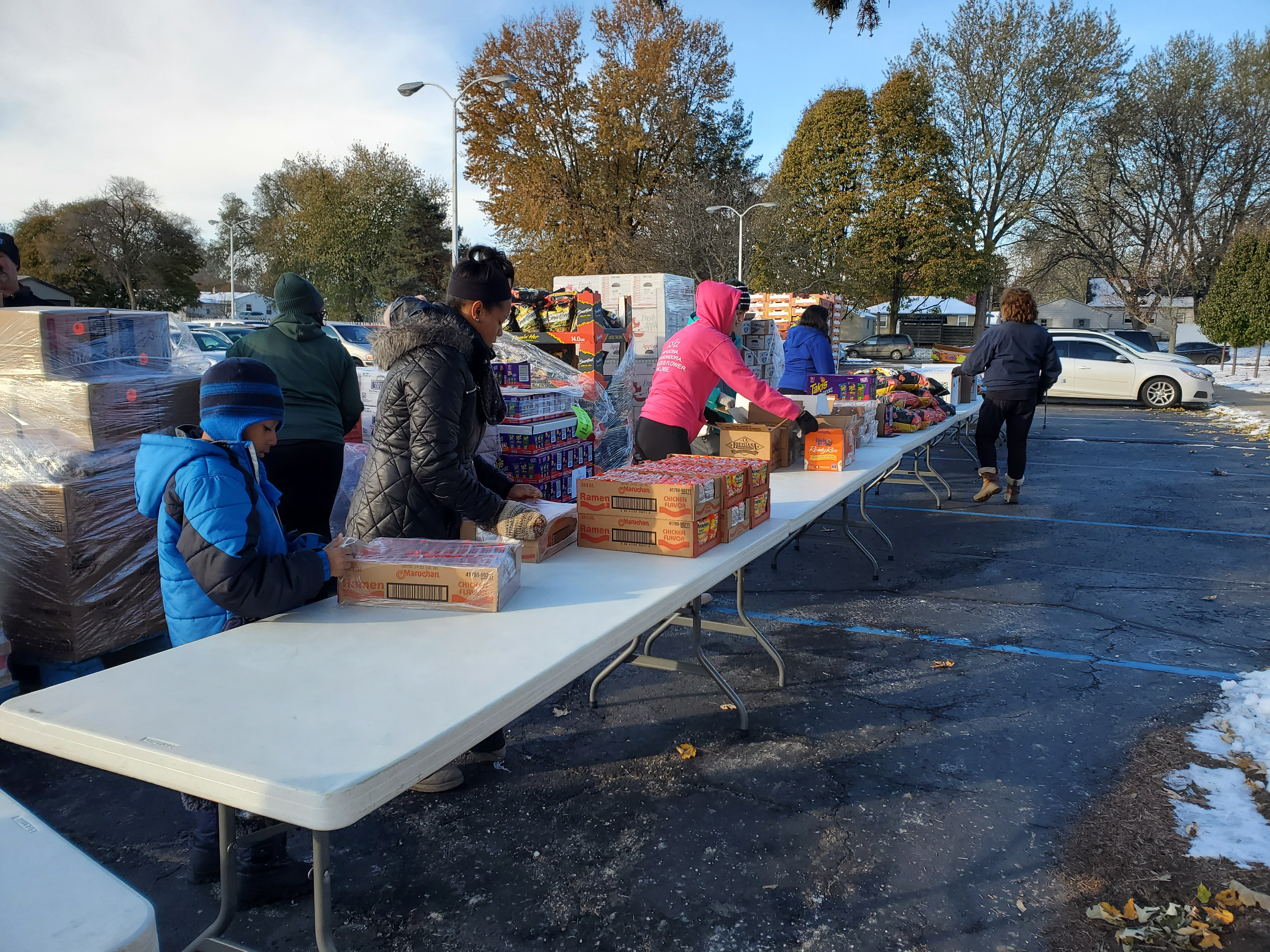 Greater Lansing Food Bank outdoor setup and volunteers
