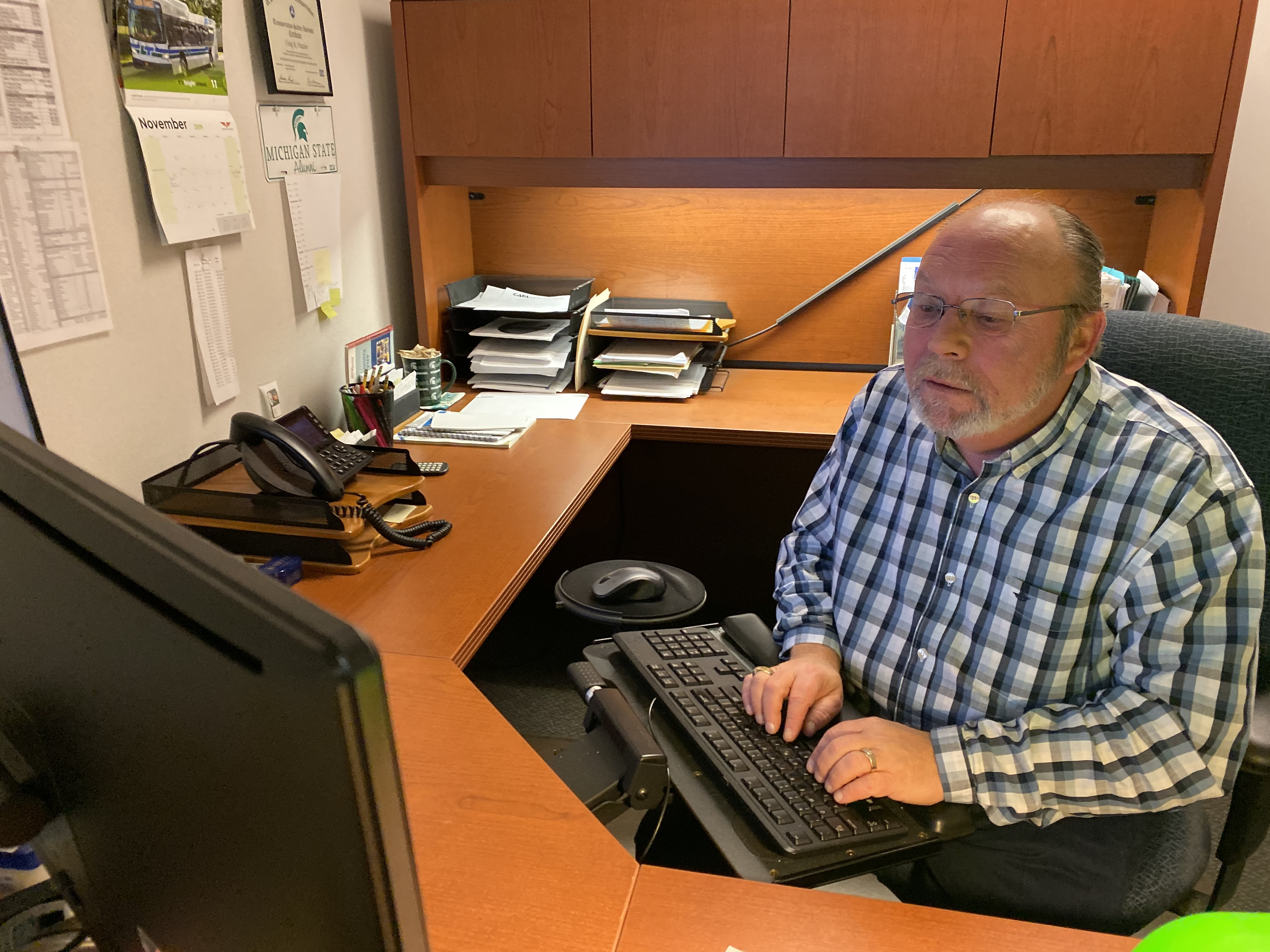 Paratransit supervisor Craig Frazier at his desk