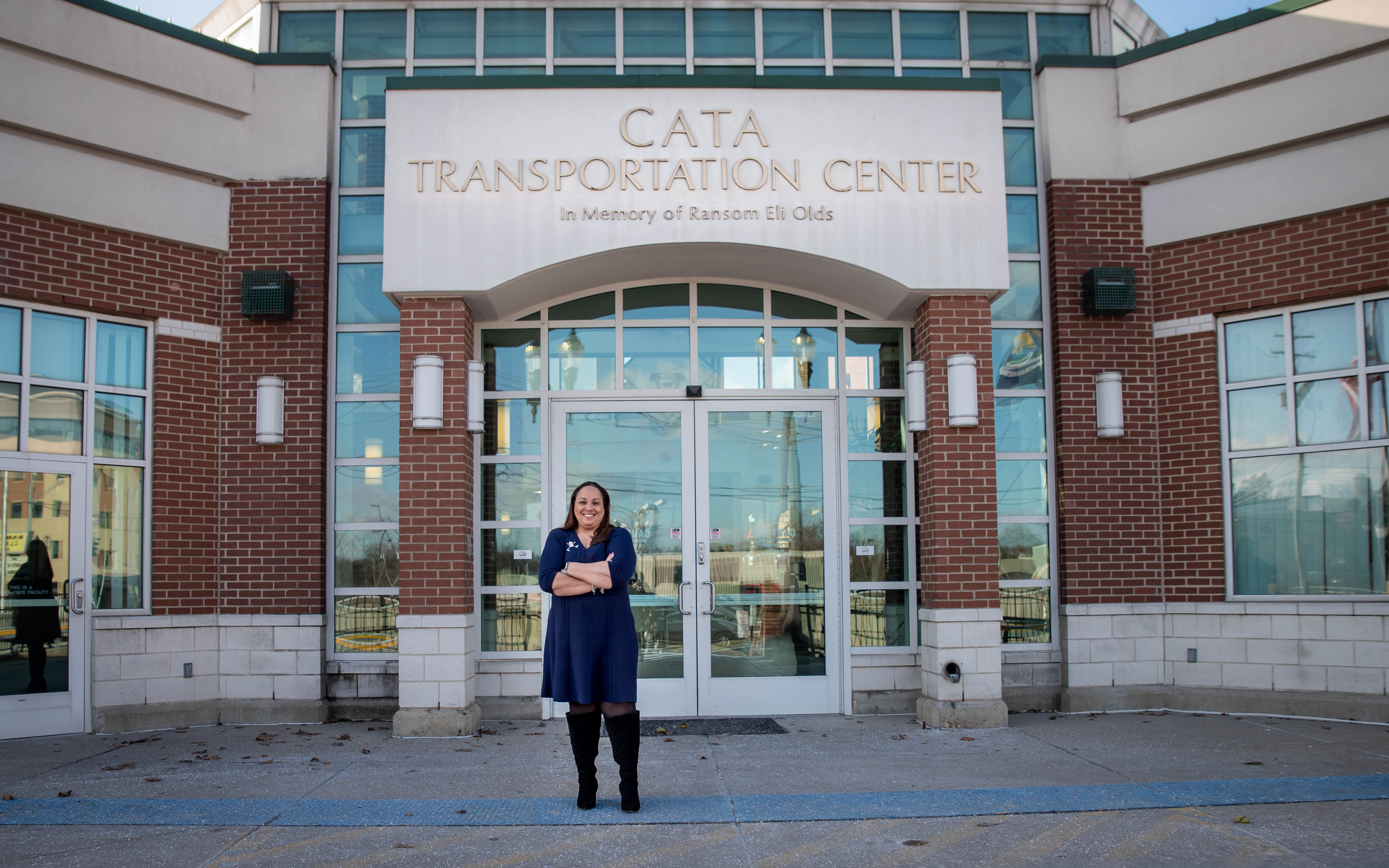 Customer Experience Manager Margaret Stephens stands in front of the CATA Transportation Center