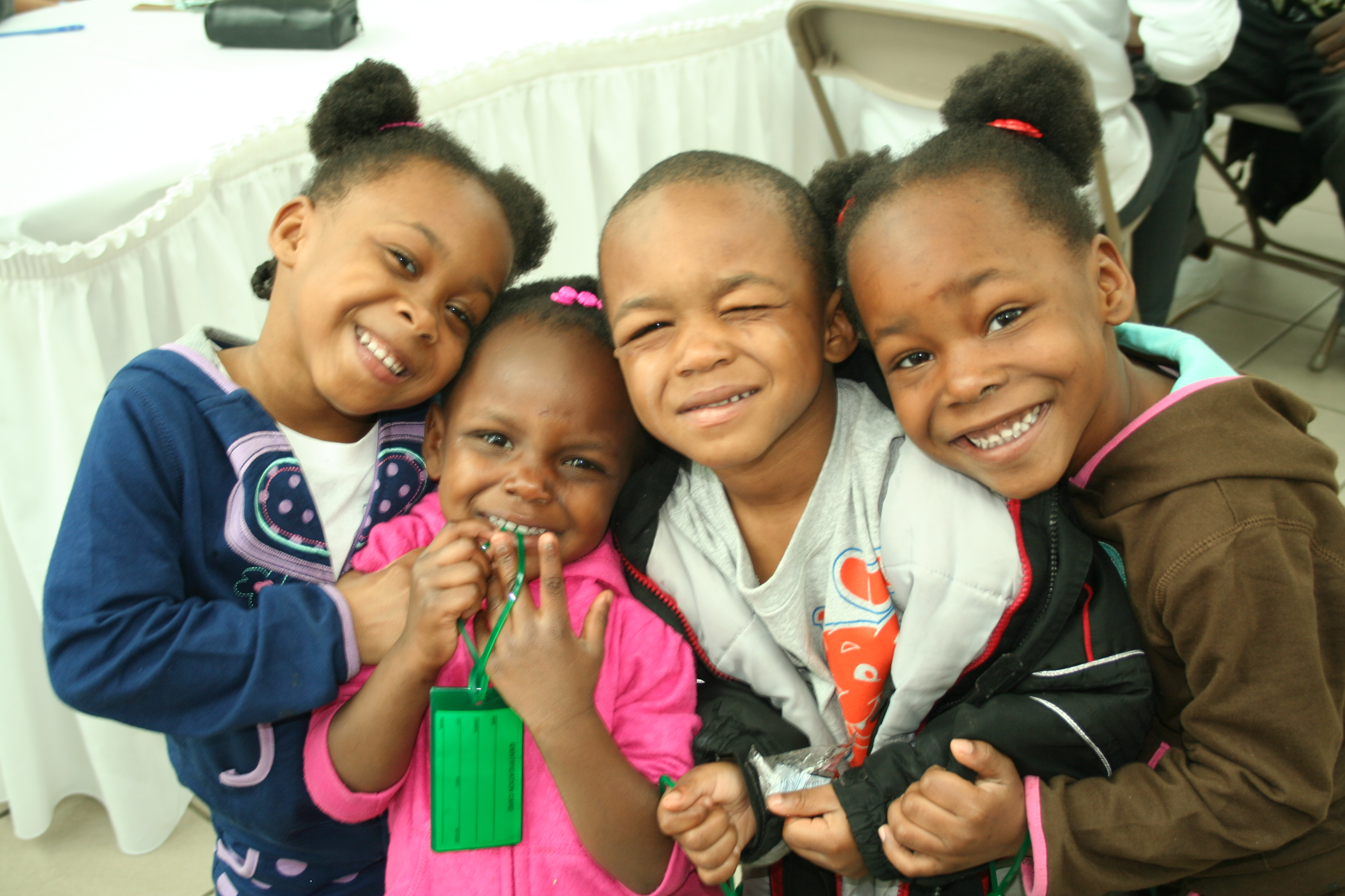 Four young smiling children