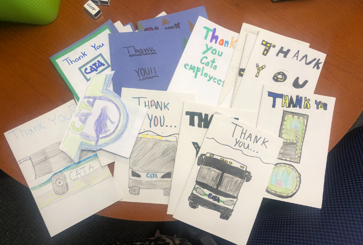 Photo of many thank you cards to bus drivers