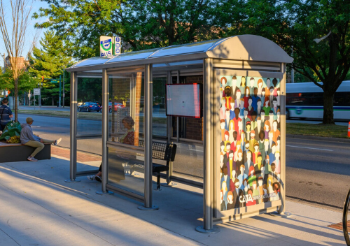 Bus Shelter Located on Grand River with mural of many people on the side.